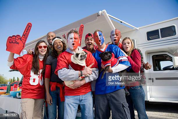 tailgating football fans - foam finger stock photos and pictures