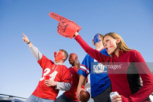 tailgating football fans - foam hand stock photos and pictures