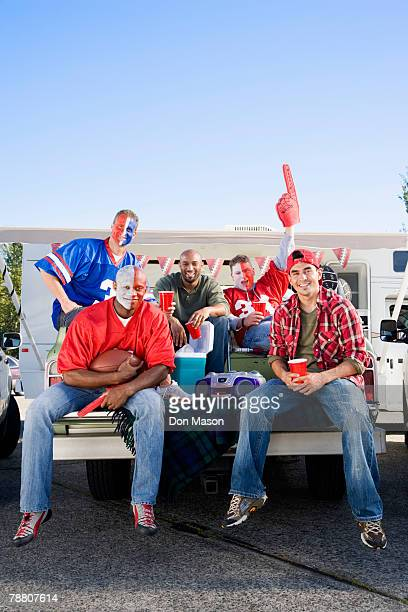 tailgating football fans - soccer body painting stock photos and pictures