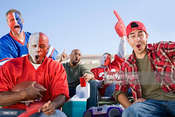 tailgating football fans - football body paint stock photos and pictures