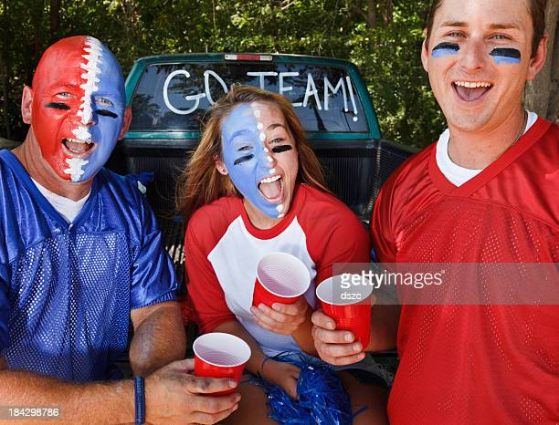 tailgating - football body paint stock photos and pictures