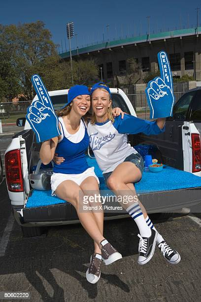 tailgating women fans - foam finger stock photos and pictures