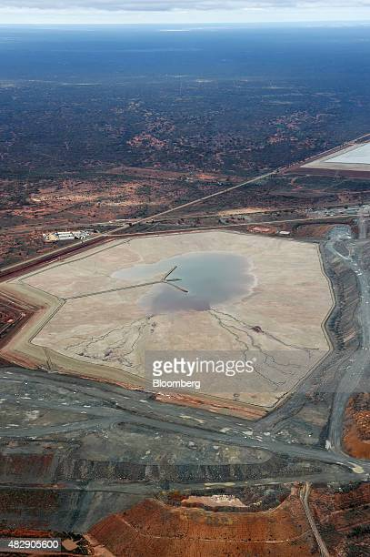 A tailings dam sits at the Fimiston Open Pit mine known as the Super Pit in this aerial photograph taken above Kalgoorlie Australia on Monday Aug 3...