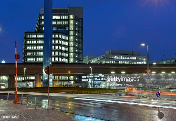 Taillights from passing traffic illuminates the road near to the entrance of the Daimler AG headquarters and the MercedesBenz plant in Stuttgart...