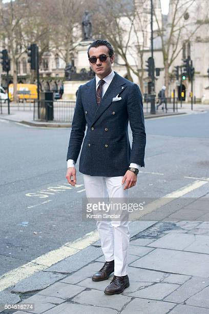 Tailor and fashion blogger Vlad Kotski wears a Suit Supply jacket trousers and tie Hugo Boss pocket square and Russell Bromley shoes on day 3 of...