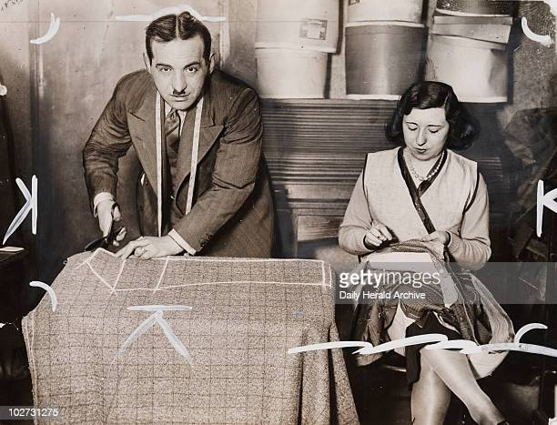 A tailor and his assistant at work March 1930 Gelatin silver print