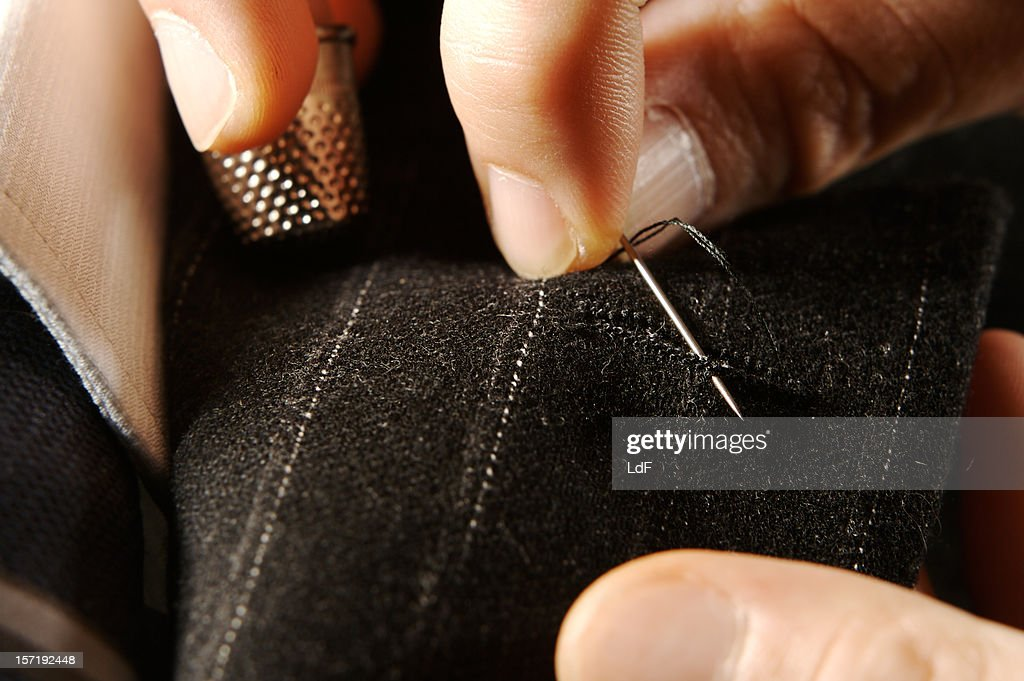 Tailor at work : Stock Photo