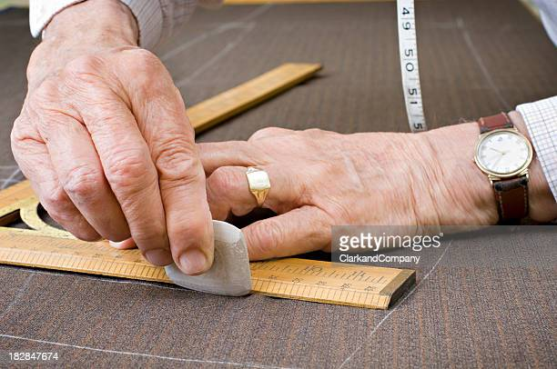 Tailor At Work With Chalk Square and Tape Measure
