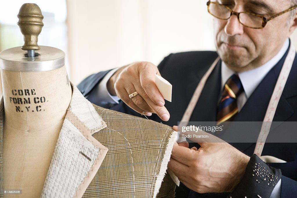 Tailor chalks unfinished jacket shoulder : Stock Photo