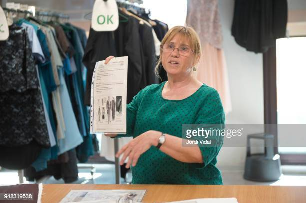 Tailor Chief Cristina Fortuny shows sketches of costume designs during the press conference for Russian Opera 'Demon' at Gran Teatre del Liceu on...