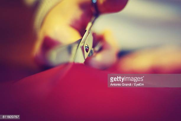 tailor cutting cloth - fashion designer stock photos and pictures
