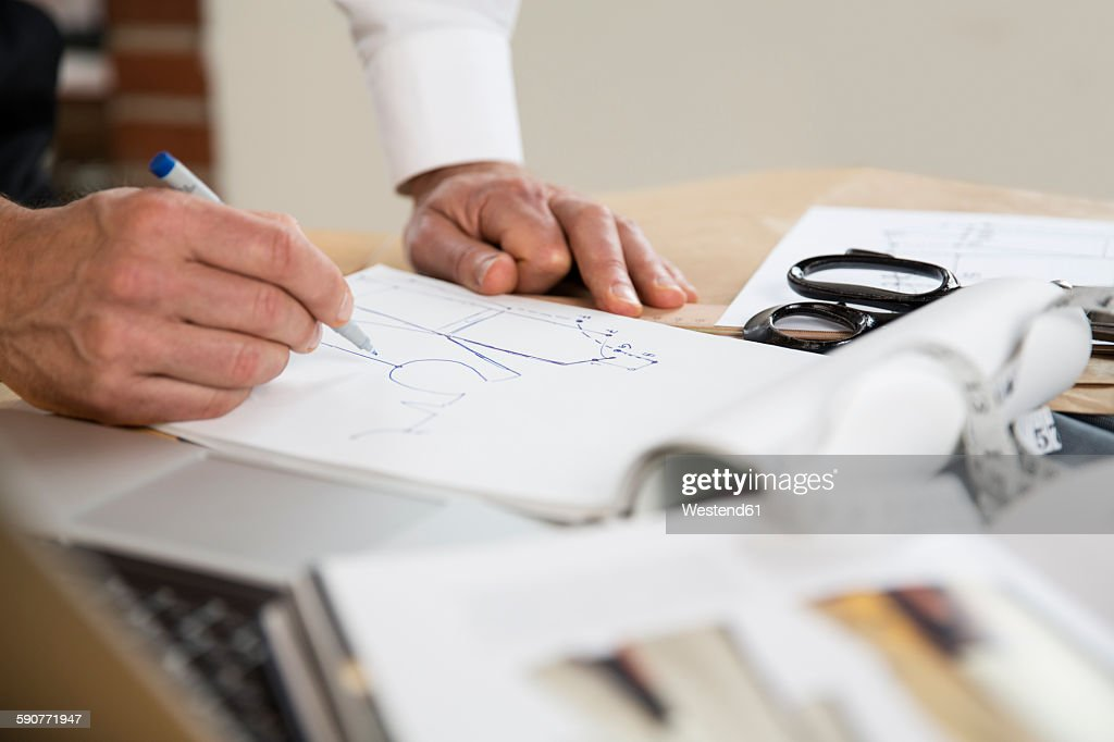 Tailor drawing cut pattern : Stock Photo