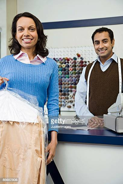 Tailor in shop with customer