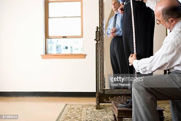 Tailor measures pant length