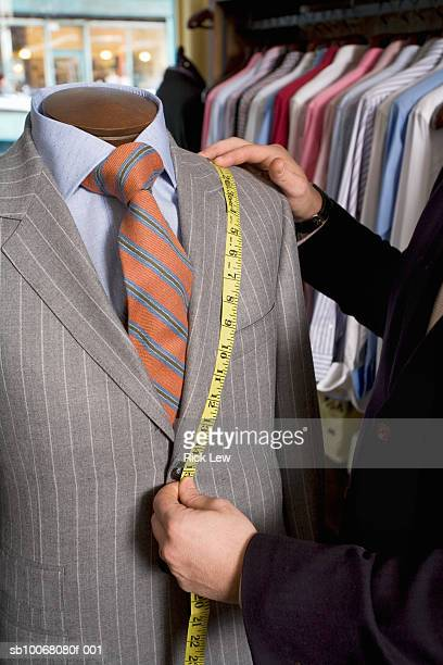 Tailor measuring jacket on dressmaker's model
