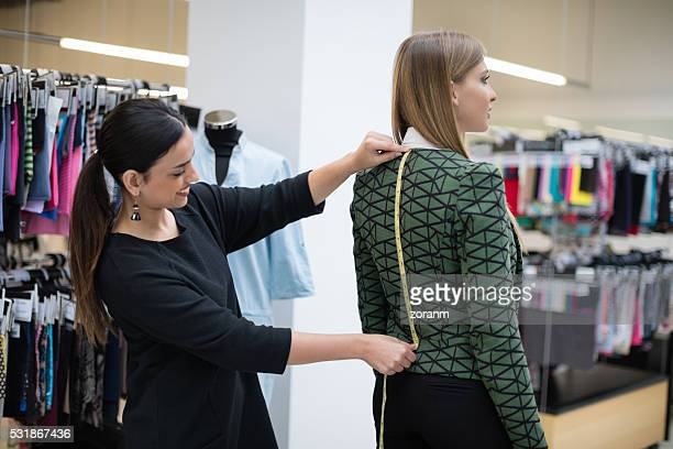 tailor measuringcustoomer's  back lenght - centimetre stock photos and pictures