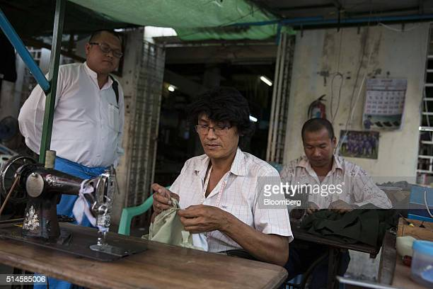 A tailor sews clothing for a customer in Naypyidaw Myanmar on Wednesday March 9 2016 The country's parliament will reveal the three candidates vying...
