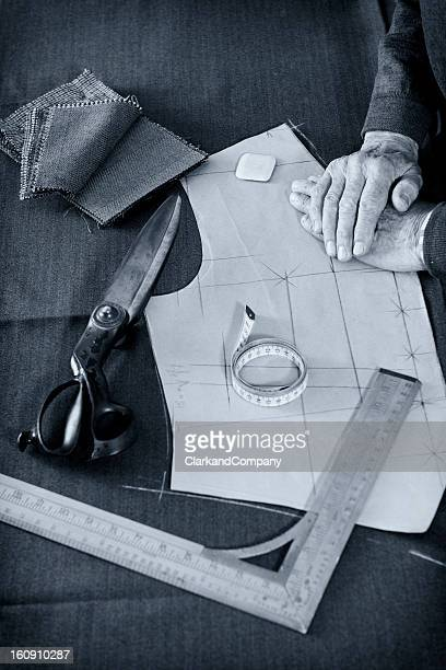 tailor starting work with his tools - tailor stock photos and pictures