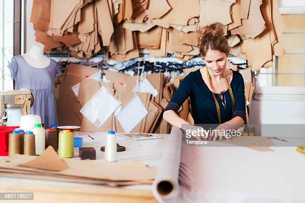 Tailor studio, fashion designers at work.