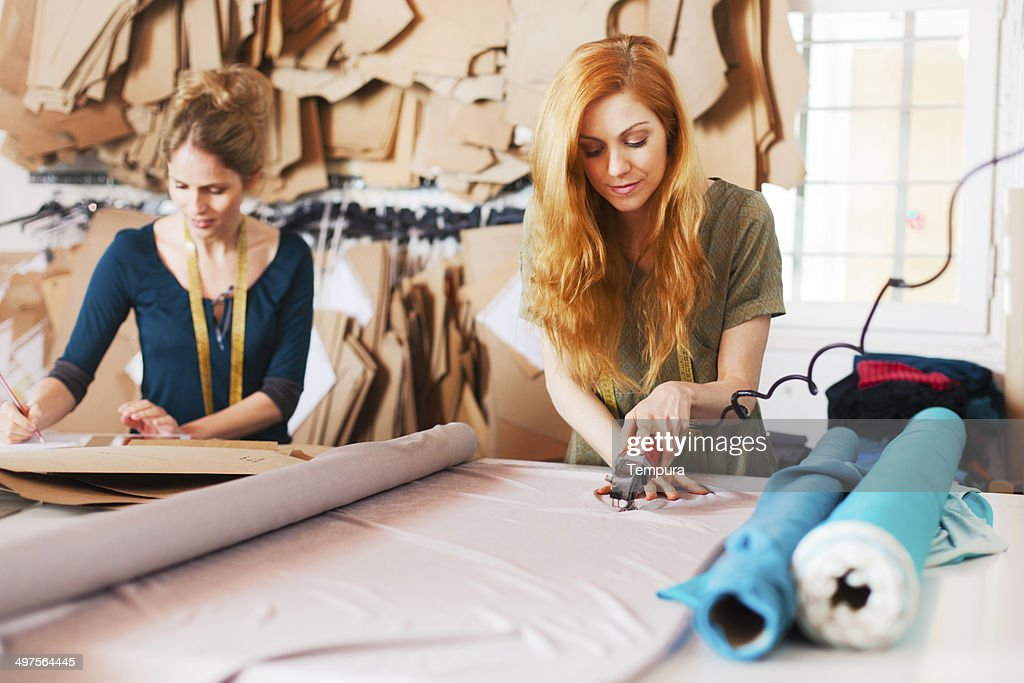 Tailor studio, fashion designers at work. : Stock Photo