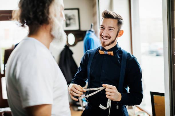 Tailor Talking To Customer