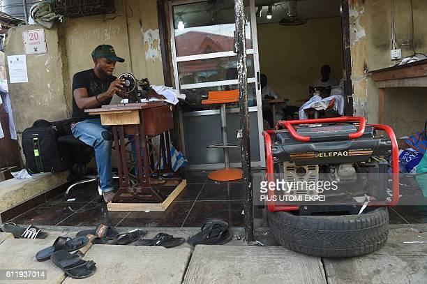 A tailor uses a generator for power due to the epileptic public power supply in Lagos on September 27 2016 Even at the best of times Nigeria which is...
