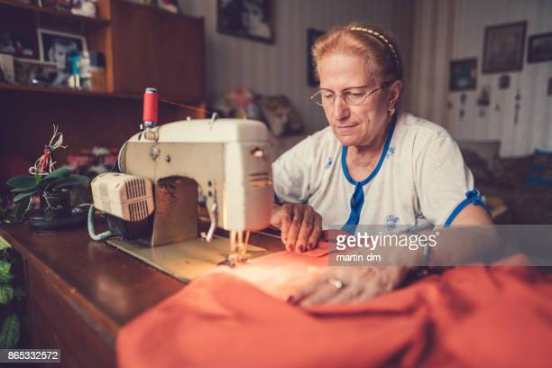Tailor woman working at the sewing machine