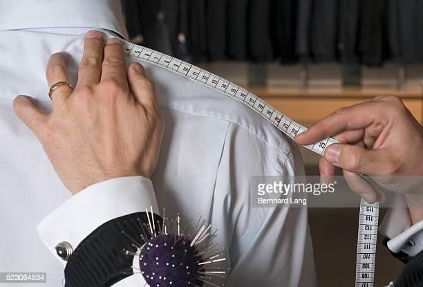tailor working on shirt - schneiderberuf stock-fotos und bilder