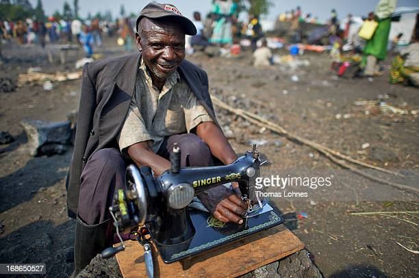 A tailor works in UNHCR camp Mugunga III for displaced persons on January 14 2013 in Goma Democratic Republic of Congo The war in Congo which has...