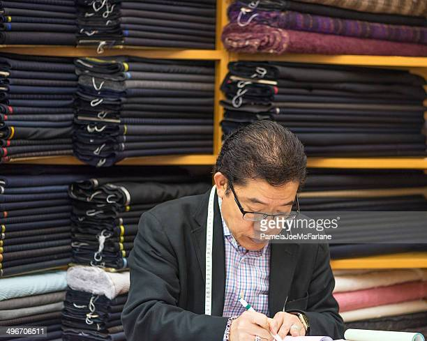 tailor writing up an invoice - custom tailored suit stock pictures, royalty-free photos & images