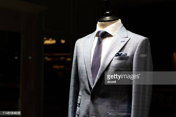 tailored suit in shop - shop window stock pictures, royalty-free photos & images