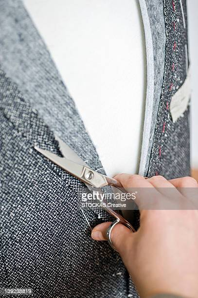 tailoress in studio at work - custom tailored suit stock pictures, royalty-free photos & images