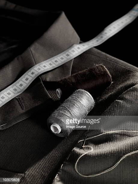 tailoring a jacket - custom tailored suit stock pictures, royalty-free photos & images