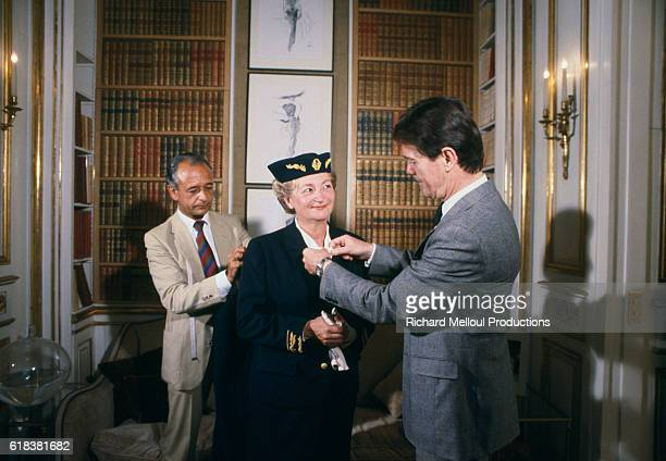 Tailors adjust the uniform of police commissioner Yvette Chassagne. Chassagne was the first female commissioner in France.