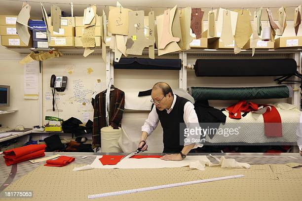Tailors at G.D. Golding, who hold a Royal Warrant for services to the Royal Household, produce bespoke garments in their workshop on September 24,...