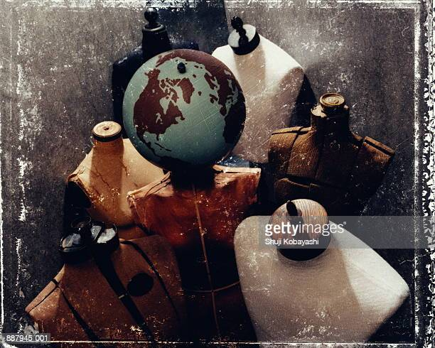 Tailor's dummies with globe, North America prominent (distressed)