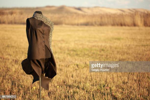 tailor's dummy with a dress in the wind. - asymmetry stock pictures, royalty-free photos & images