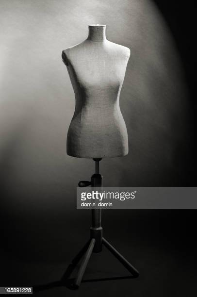 Tailor's female mannequin torso in shadow