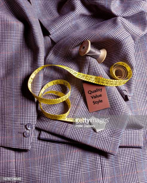 tailor's needle and thread on suit jacket - custom tailored suit stock pictures, royalty-free photos & images
