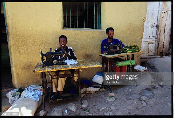 Tailors Sewing in the Street