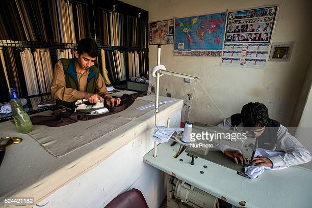 Tailors shop of traditional Afghan clothes on 24th October 2014 in Shahre Naw Kabul Afghanistan Traditional male clothing in Afghanistan is called...
