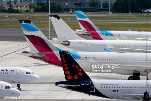 Tails of airliners are seen in the Brussels airport on July 29, 2020 in Zaventem, Belgium. The Empennage is a structure at the rear of an aircraft...