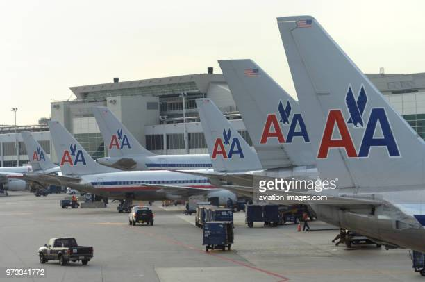 Tails of American Airlines Boeing 737-800s, 757-200s and Airbus A300 parked at the terminal.