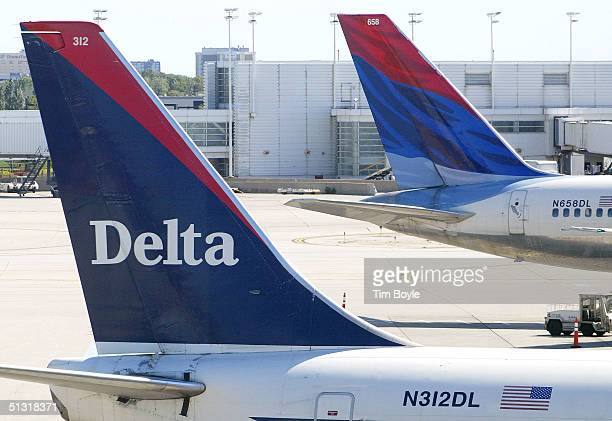 Tails of two Delta Air Lines jets are visible at their gates September 17, 2004 at O'Hare International Airport in Chicago, Illinois. Delta Air Lines...