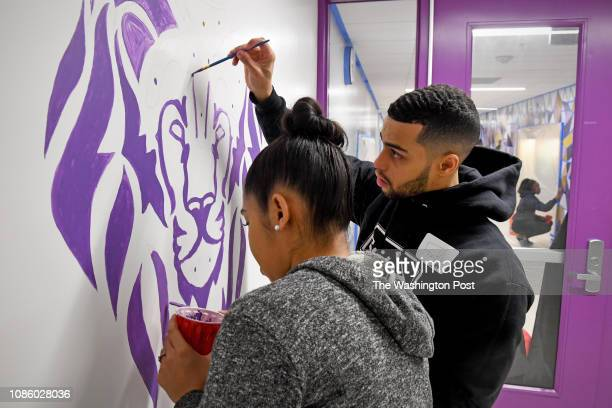 TaiLyn Parboosingh left and Franky Acevedo help to paint a mural on the school hallway during the Martin Luther King Jr National Day of Service at...