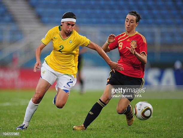 Tainara of Brazil is challenged by Paloma Lazaro of Spain during the FIFA U17 Women's World Cup Quarter Final match between Spain and Brazil at the...