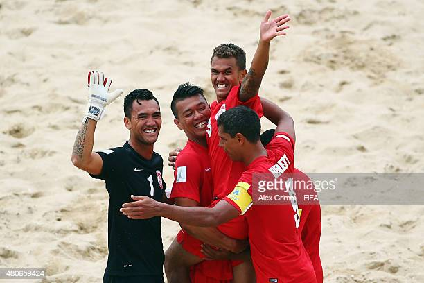 Tainui Lehartel of Tahiti celebrates his team's fifth goal with team mates during the FIFA Beach Soccer World Cup Portugal 2015 Group D match between...