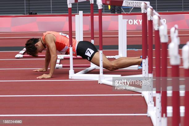 Taio Kanai of Team Japan falls while competing in the Men's 110m Hurdles Semi-Final on day twelve of the Tokyo 2020 Olympic Games at Olympic Stadium...