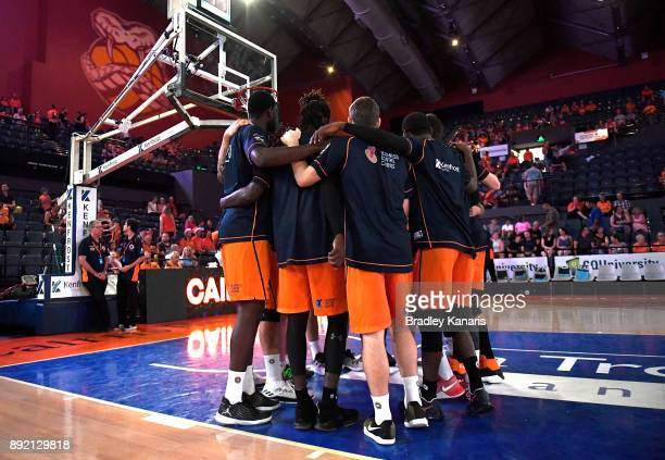 Taipans players embrace before the round 10 NBL match between the Cairns Taipans and the Brisbane Bullets at Cairns Convention Centre on December 14...