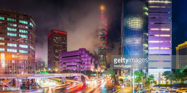 taipei 101 neon night skyscrapers busy highways illuminated panorama taiwan - taipei stock pictures, royalty-free photos & images